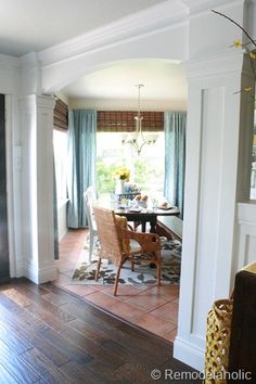 Style/placement of window treatments in eat-in kitchen, columns framing kitchen-to-living-room-transition