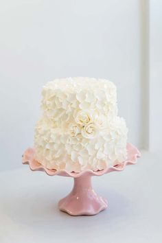 """Cake by Layers Cakes in Halifax From the designer: """"The inspiration for this cake was based on classic white and romance. The ruffled petals are soft and romantic and the white roses are a classic wedding flower. Suited for more of a small and intimate wedding, this two-tiered cake features a stylish and formal look. The fondant-covered cake is decorated with white sugar petals and white sugar roses."""" Photo courtesy Candace Berry Photography ."""