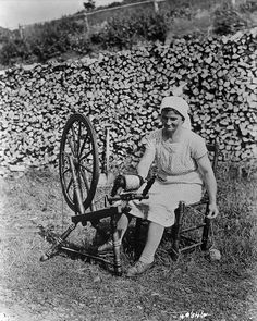 Acadian woman spinning wool, Cape Breton, Nova Scotia, 1938.
