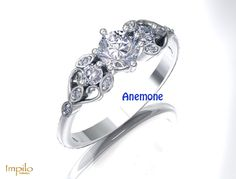 """""""Anemone"""" - Round brilliant cut diamond centre stone with a small round brilliant cut diamond on each side. In the intricate design on either side of the ring are smaller diamonds Intricate Engagement Ring, Diamond Engagement Rings, Country Girls, Heart Ring, Dream Wedding, Stone, Centre, Diamonds, Collection"""