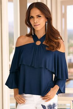 The front mirrors the back of this sexy knit top with a single ring accentuating layers of ruffles draping the cold-shoulder neckline. Trendy Tops, Cute Tops, Casual Tops, Blouse Styles, Blouse Designs, Ankara Peplum Tops, Look Fashion, Fashion Outfits, Neck Designs For Suits