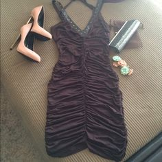 Leather Studded Bodycon Dress (Chocolate Brown) Sexy Bodycon Dress with Faux leather shoulder straps with gold stud accents. Also has a halter neck tie. Has great ruching on sides that help cinch waistline and also hide flaws. Great find from L.A. Size Medium and very stretchy. Is Bella Dresses
