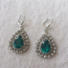 Green sparklers Beautiful green sparkly earrings. These have just arrived from India and are brand new without tags. So sparkly and very lightweight. Jewelry Earrings