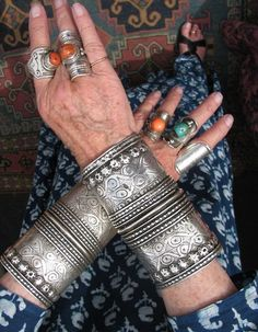 Going Tribal ~ Unfortunately no details to original source | The bracelets I would say are from Central Asia (Turkomen) and the rings are similar to those found in Tibet