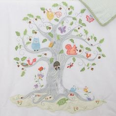 beauuuutiful appliqués and embroideries (Wishing Tree crib quilt)