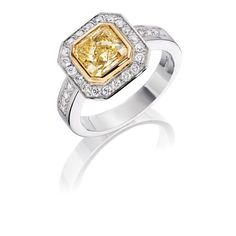 18ct White gold ring set with 2.01ct Natural yellow diamond, surrounded by Brilliant Cut diamonds