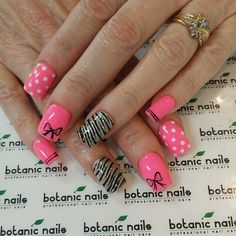 Pink nails with bow, white polka dots, black stripes and glitter with zebra stripes designs