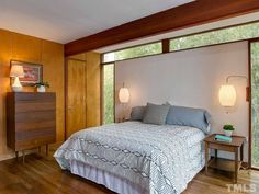 This delightful home sits in a small patch of woods two blocks away from the University of North Carolina Campus in Chapel Hill. Completed in 1955, it was designed for the Julian family by notable mid-century architect George Matsumoto.