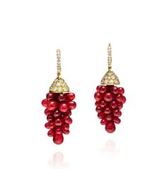 A PAIR OF RUBY BEADS AND DIAMOND EAR PENDANTS. Designed as grape clusters, set with ruby beads weighing 40 carats in total, capped by pave-set round diamonds, mounted in 18K gold, approximately 3.90 cm long.