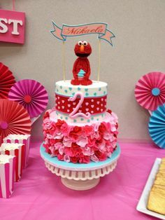 Fantastic cake at an Elmo girly birthday party! See more party planning ideas at CatchMyParty.com!