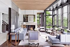 An artwork by Terry Winters overlooks the Nashville, Tennessee, living room of interior designer Ray Booth and television executive John Shea.