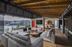 CASA RR: Salas de estilo Rural por BURO ARQUITECTURA
