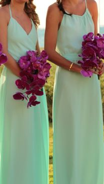 Isn't this the prettiest color for a beach wedding?? Paired with bright purple orchid bouquets - oh my. This is just perfect!