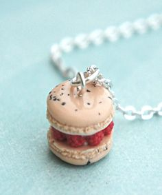 This necklace features a handmade raspberries and cream filled french macaron pendant. The macaron pendant measures inches in diameter and is attached to a silver tone chain necklace that measures 24 inches in length. Macaron Cake, Macaron Recipe, French Macaroons, Miniature Food, Afternoon Tea, Chocolate Chip Cookies, Raspberry, Sweet Treats, Bakery