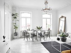 With only two weeks to go until we start painting our new floors, I'm  obsessing over this perfectly white and bright home in Stockholm. I love  the quaint balcony, the stylish built-ins, the high ceilings and the  pairing of minimalist with eclectic furnishings. How amazing is that brass  mirro