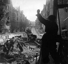Soviet artillerymen prepare to fire a 122 mm M1938 (M-30) howitzer at German forces during the Battle of Berlin, May 1945.