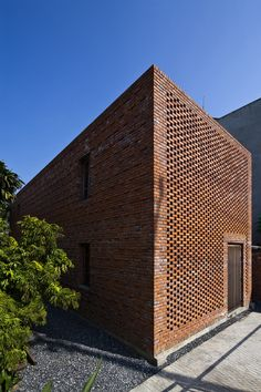 Vietnamese Home with Termite-Inspired Brickwork