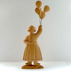Seller of balloons. Balloons, Carving, Disney Princess, Disney Characters, Wood, Artist, Globes, Woodwind Instrument, Wood Carvings