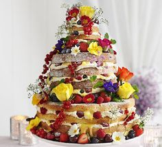 Frances Quinn's Summer's day wedding cake. Frances creates her own version of the latest bridal trend - the 'naked' cake. She skips the traditional fondant icing for mascarpone seasonal berries.