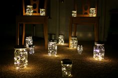 """Unique lighting idea - each jar is """"loaded"""" with a string of battery-powered lights. 30 Lantern Wedding Package by ShelbyLea on Etsy, $300.00"""