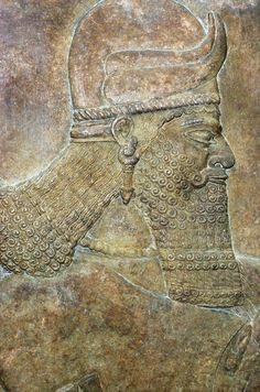 King Ashurnasirpal II, detail from pouring libation on dead lion; Nimrud, c. 865 BC.                [British Museum]