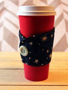 A personal favorite from my Etsy shop https://www.etsy.com/listing/258452803/night-sky-beverage-cozy-sleeve-with