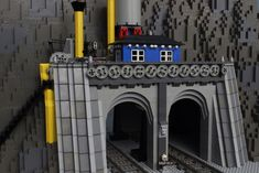 Gears as an architectural feature, see them and the pump in motion at youtu. Lego Tractor, Lego Winter Village, Paper Train, Train Tunnel, Lego Kits, Lego Trains, Lego Modular, Lego Castle, Lego Room
