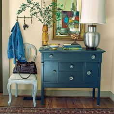 Placed in the foyer, a small dresser becomes a convenient spot for dropping keys or mail. The chest goes from country to chic in no time                                            with black lacquer and antique glass door knobs.
