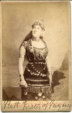 "Cabinet photograph of Bessie Armytage as Ruth in a DOC touring production of ""The Pirates of Penzance"" in 1882. Photo by Edwards & Simonton, Dublin. Inscribed ""Ruth Pirates of Penzance"" to bottom of front mount and ""Yours faithfully Bessie Armytage"" to reverse."