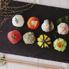 Recipe with video instructions: How to make Ball Shaped Sushi Ingredients: 1 cup cooked rice, 1 2/3 tbsp rice vinegar, 1 tbsp sugar, 1 tsp salt, (sushi ingredients), 1 slice tuna, 1 slice squid, 1 slice salmon, 1 slice fresh sardine, Tororo konbu (flaked konbu seaweed), Sliced Japanese egg omelette, 4 thin strips of nori, 5 thin slices radish, 3 thin slices cucumber, wasabi, (garnish), pickled ginger, chopped chives, perilla leaves, cream cheese, lemon wedge, dill, salmon eggs, soy sauce...