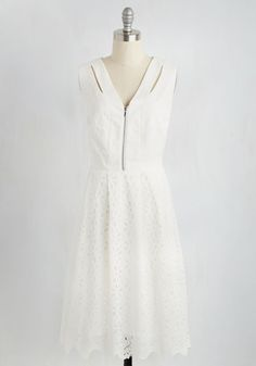 When it comes to updating the LWD world, you've got some ideas - starting with this floral, eyeleted A-line! Contoured with solid bands along the V-neckline and waist, and given added edginess with shoulder cutouts and a silver zipper, this pleated dress is ready to rock the fab fashion world!