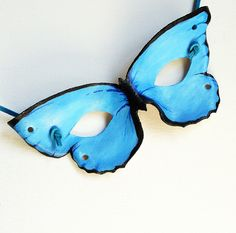Crafted from leather and hand-painted, this butterfly mask will stand up to years and years of Halloween trick-or-treating and imaginary play. Craft easy cardboard wings to complete the look.