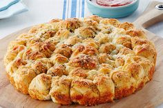Transform a can of refrigerated biscuits into a glorious savory monkey bread that's cheesy with Parmesan and seasoned with garlic powder.