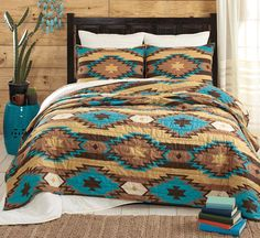 This Southwest bedroom decorating idea features The Santa Fe Turquoise quilt bed. This Southwest bedroom decorating idea features The Santa Fe Turquoise quilt bedding set. It features hues of caramel, turquoise and tan creating a motif design. Western Quilts, Western Rooms, Western Bedding, Western Chic, Southwest Bedroom, Southwest Quilts, Turquoise Bedding, Cool Beds, Quilt Sets