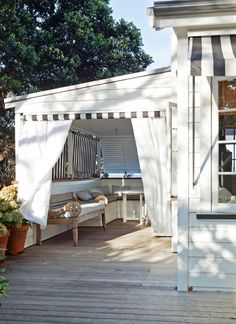 Striped blinds can be rolled down to turn the outdoor seating area into a bedroom or private afternoon napping spot and to regulate sea breezes. - See more at: