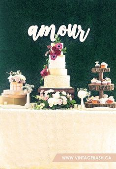 AMOUR: Beautiful Rustic Wedding Dessert Table / Candy Buffet / Cake Table with a Boxwood Greenery Backdrop and a custom letter - setup + decor by VintageBASH.ca // floral design by FloralBASH.ca // photography by EMBLAZEphotography.com // cakes by cakedup.org + facebook.com/dolcevitasweets // macarons by instagram.com/ohmymacarons // venue by willowspringswinery.com