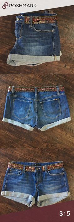 Denim shorts Denim shorts with a cuffed him. Beaded detail around the waist with red and yellow stitching. Shorts Jean Shorts