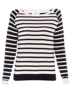 A striped sweater is a classic addition to any wardrobe, and we think this version by Allude is exceptional. Crafted from super-soft merino wool, this ivory and navy striped sweater features raglan sleeves that feature a contrasting navy and ivory stripe. The wide navy band at the hem creates a flattering effect. Wear this timeless style with jeans and a leather tote during the day. In the evening, pair it with ivory trousers and a woven bag for a look that is eye-catching and chic.