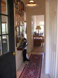 hallway, gallery wall, entry way, black door