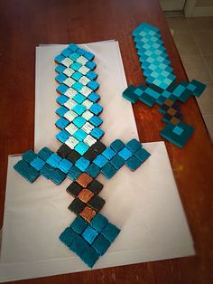 My son wanted a Minecraft diamond sword cake for his birthday, and a diamond sword cake he got!
