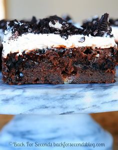 Marshmallow Oreo Fudge Cake - Rich, fudgy, gooey, and perfect for a crowd!  #pokecake #chocolate #dessert
