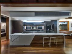 Kitchen Island Bench Designs mirror splashback, like how it reflects the light outside from a
