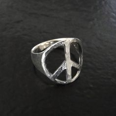 I adore this     Peace Sign Ring  Sterling Silver Hammered  Sizes by classicdesigns, $32.00