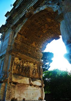 Arch of Titus, concrete and marbel construction, Ancient art 81CE, located in Rome, the arch displays some of the common architectural styles of the Roman Empire and displays Roman characters across the front.