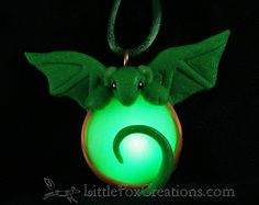 Glowing Flora Dragon Amulet by LittleFoxCreationsWA on Etsy $20.00 Amulet dragons are small dragons that bond to amulets. No one is quite sure where the amulets come from, but if you are lucky enough to find one you will have a dragon friend for life. Amulet dragons spend most of their time protecting the light that they collect. http://littlefoxcreations.com/