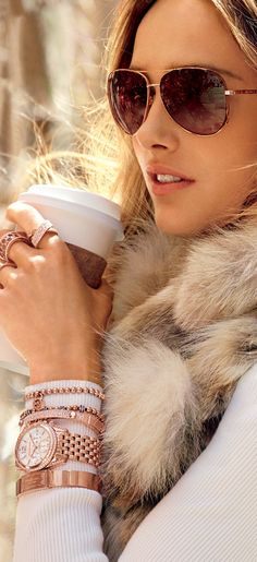 Fur and coffee :). Would go easy on the jewelry though-- too much here.