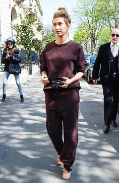 Hailey Baldwin wore the outfit American It girls love while shopping in Paris. Find out how you can re-create her look here.