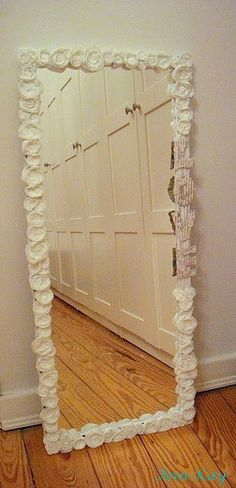 For powder room, but in RED! $5 mirror from WalMart, flowers from Hobby Lobby, and a hot glue gun. So cute