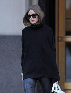 Olivia Palermo in a black wrap sweater. TopShelfClothes.com