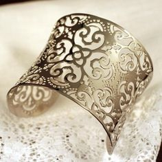 This Irish lace cuff emulates the delicate beauty of traditional hand crocheted Irish lace and the harden strength and perseverance of the Irish women who made it.